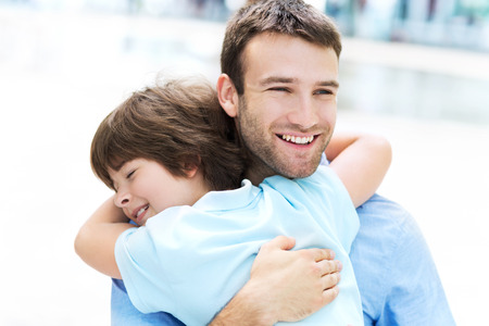 dad and child: Father and son hugging Stock Photo