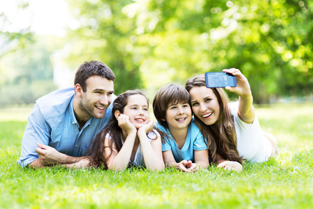 family picture: Family taking photo of themselves Stock Photo