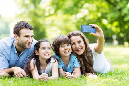 are taking: Family taking photo of themselves Stock Photo