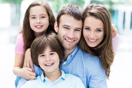 mothers group: Young family smiling Stock Photo