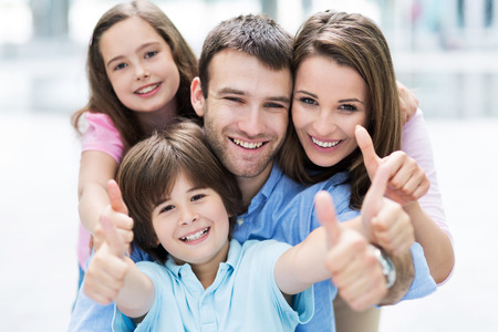 thumbs: Family showing thumbs up Stock Photo