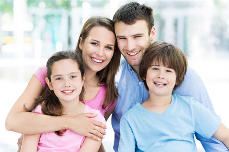 young man smiling: Young family smiling Stock Photo