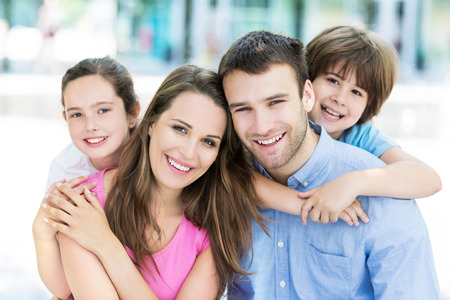 Young family smiling Banque d'images