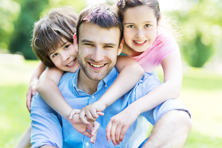 father: Father with two children Stock Photo