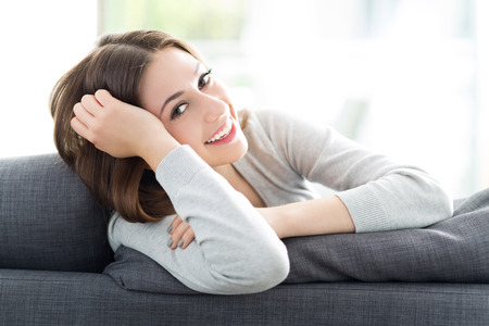 Woman relaxing on sofa