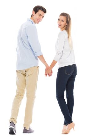 full shot: Young couple standing Stock Photo