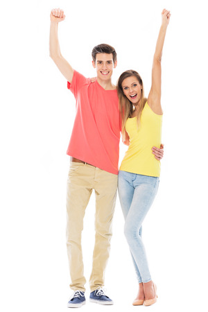 cheer full: Young couple with arms raised
