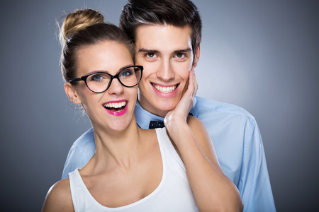 shot glasses: Young couple smiling