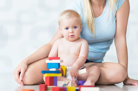 baby playing: Mother and baby playing with blocks Stock Photo