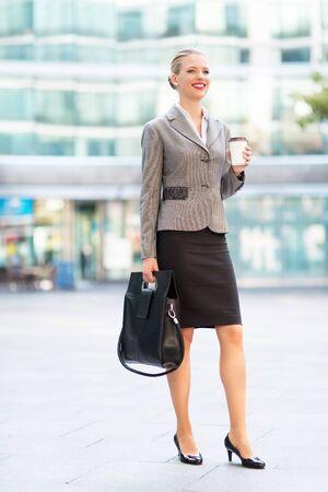 successful woman: Young businesswoman outdoors