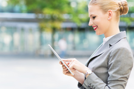 using tablet: Businesswoman using digital tablet