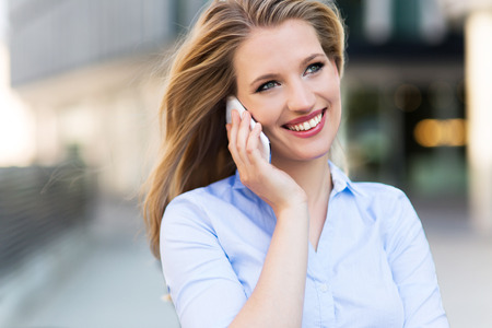 woman on phone: Woman using mobile phone