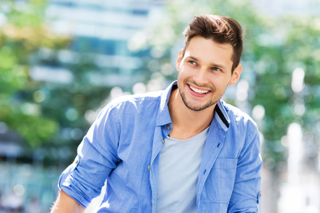 man outdoors: young man smiling