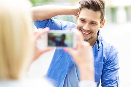 taking photo: Couple taking photo with smartphone Stock Photo