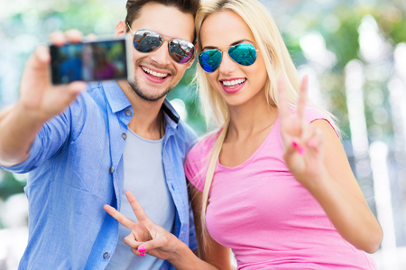 couple having fun: Couple taking a selfie with smartphone
