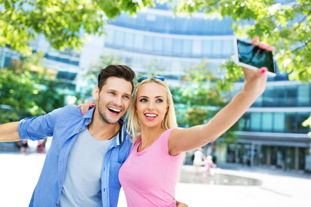 PRETTY WOMEN: Couple taking a selfie with smartphone