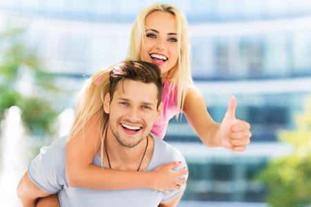 Happy couple showing thumbs up Foto de archivo