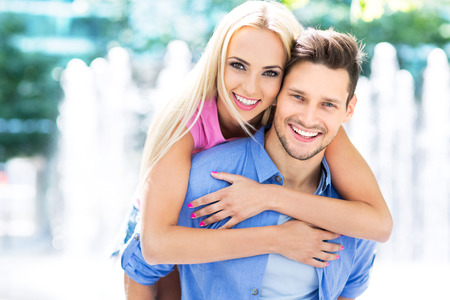 young couple smiling: Young couple smiling