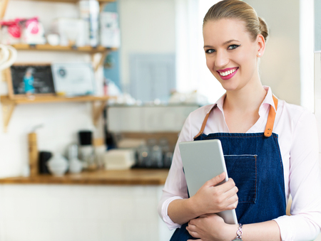 Woman working in coffee shop Banco de Imagens
