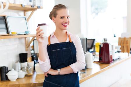working woman: Woman working in coffee shop Stock Photo
