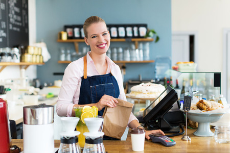 seller: Woman working in coffee shop Stock Photo