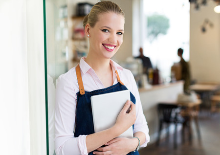 working woman: Woman working at cafe