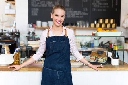 small business owner: Woman working at cafe