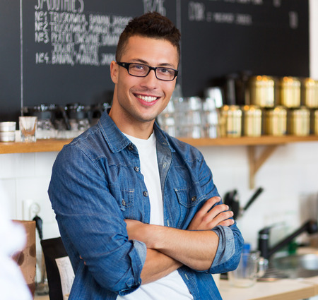 casual caucasian: Cafe owner Stock Photo