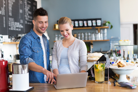Small business owners in caf 스톡 콘텐츠