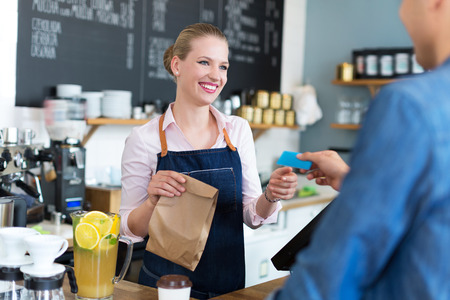 shop assistant: Waitress serving customer at the caf