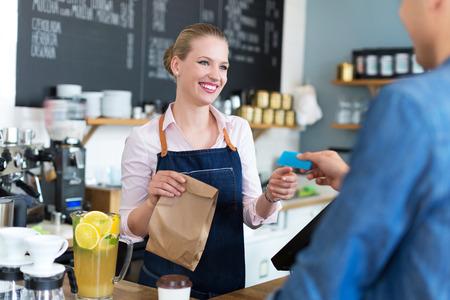 Waitress serving customer at the caf