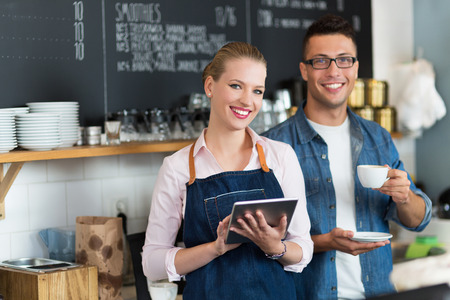 two people: Small business owners in caf Stock Photo