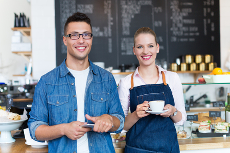 woman standing: Young cafe owners