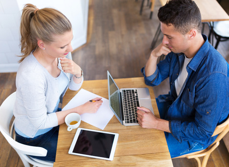 confident business woman: Couple working at cafe