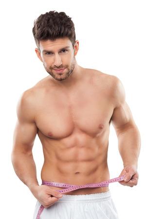 nude body: Man measuring his waist Stock Photo