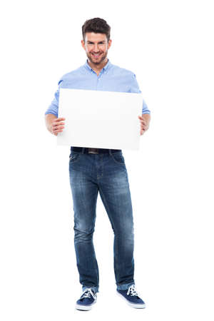 white poster: Young man with blank poster