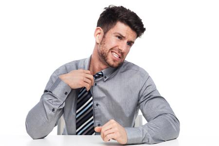 nervousness: Businessman loosening his tie Stock Photo