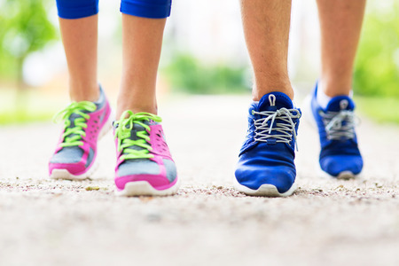 people in action: Couple running feet close-up Stock Photo