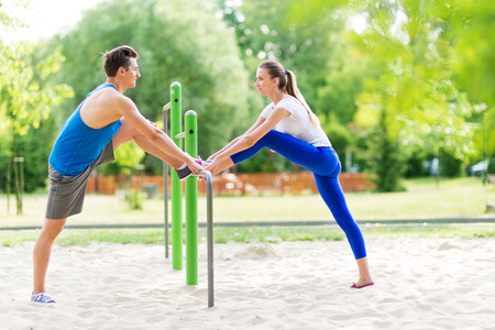 Couple exercising at outdoor gym Stock Photo