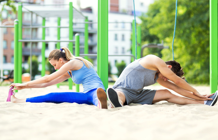 Young couple training outdoors photo