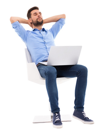laptop stand: Relaxed young man
