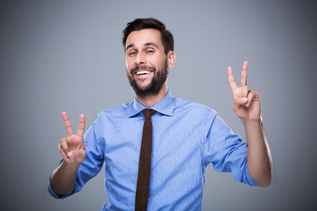 sign: Man Making Peace Sign Stock Photo