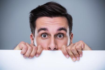 Man hiding behind a copy space