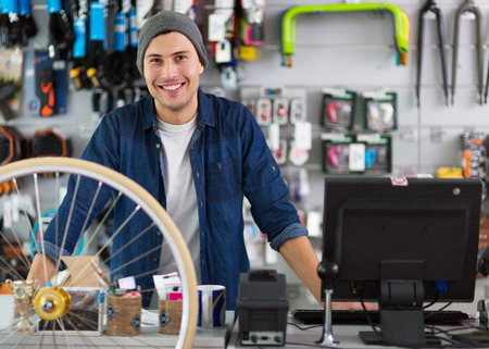 Bike shop owner smiling Stock Photo