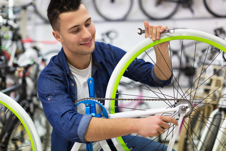 Bicycle technician in workshop