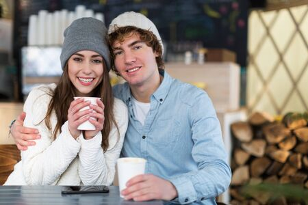 hot drink: Couple having a hot drink on winter day