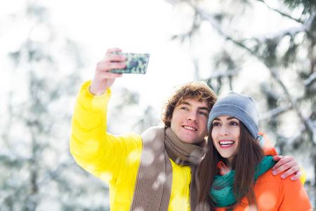 couple winter: Winter couple taking selfie