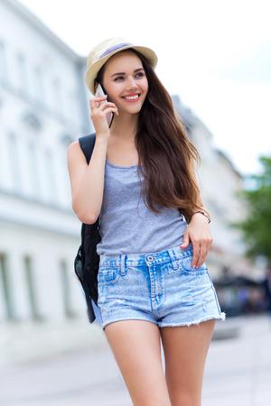 beautiful teen: Woman with mobile phone walking Stock Photo