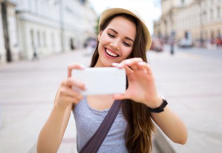 taking photo: Young woman taking photo