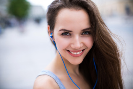 Woman listening to music outdoors Stock Photo